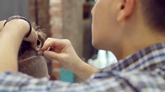 Master Barber shaves a customer businessman with a straight razor Stock Footage