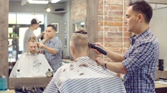 Master hair creates a stylish haircut head , beard, and mustache to his client Stock Footage