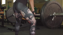 Athletic girl performs exercise dead-lift with a barbell in the gym Stock Footage