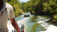 Indian man ride a boat on Kalu Ganga river in Sri Lanka Stock Footage