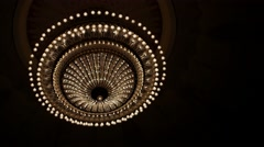 Chandelier in the theater extinguishing Stock Footage