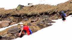 Climber smeared with cream for sunburn, not to burn. Motivation. Mountain Stock Footage