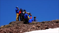 Climbers are photographed on a background of mountains. Motivation. Stock Footage