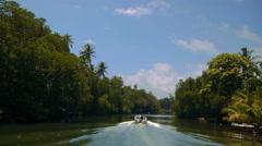 People blurred far away on boat travel Kalu Ganga river in Sri Lanka Stock Footage