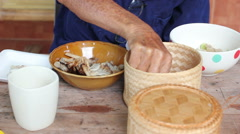 Closeup asian old man eating food with sticky rice, Thailand Stock Footage
