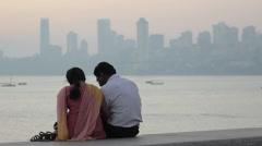 Loving couple on background of Mumbai Stock Footage