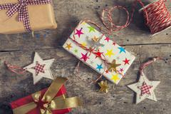 Process of packing holiday gifts with effect instagram Stock Photos