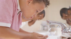 4K Father & son in bathroom in the morning washing & getting ready together Stock Footage