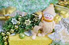 Christmas arrangement in green and gold tones. Cheerful Snowman, gifts Stock Photos