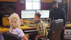 4K Music artist in recording studio, mixing a track with producer & engineer Stock Footage