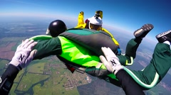 Skydivers jump out of airplane Stock Footage