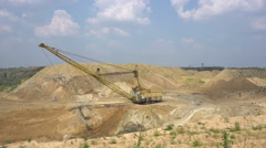 The excavator works in a quarry Stock Footage
