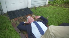 Man slips on wet sidewalk (slow-mo) Stock Footage