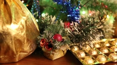 Sack with gifts and candy under the Christmas tree with blinking garlands Stock Footage