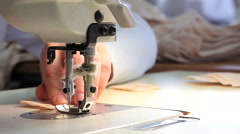 Seamstress at work by the sewing-machine Stock Footage