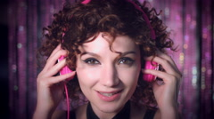 4k Disco Curly Sexy Woman Putting on Pink Headphones Stock Footage