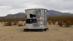 Zoom Out of Abandon Water Tank in the Mojave Desert Stock Footage