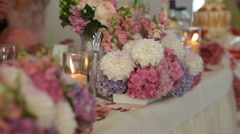 Beautiful flower decoration for the table setted for wedding celebration Stock Footage