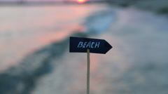 Beaches resorts idea - sign and sunset Stock Footage