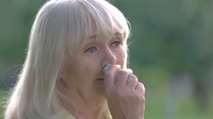 Woman wiping nose with handkerchief. Stock Footage