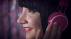 4k Disco Brunette Sexy Woman Listening to Music with Pink Headphones, from side Stock Footage