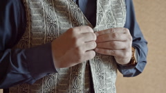 Mature Man Buttoning His Vest, Close-Up Stock Footage