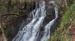 Cleddon Falls waterfall AONB River Wye, water cascades over layers of rock Stock Footage