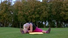Senior woman stretching. Stock Footage