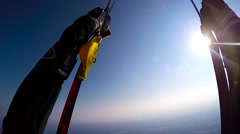 Skydiver opening parachute Stock Footage