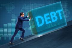 Businessman in debt business concept Stock Photos