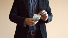 Man In Suit And One Hundreed Dollar Bills In His Hand Stock Footage