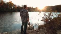 Taking Photographs on Lake at Sunset Stock Footage