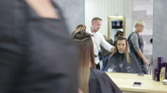 Professional stylist dries hair the hair dryer after hair dyeing Stock Footage