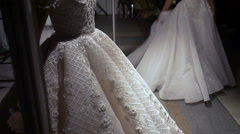 Two models in beautiful wedding dresses pose for the photographers and prepared Stock Footage