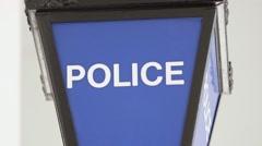 Tilt Down onto British Police Light, UK. Stock Footage
