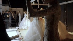 Female models prepare on the backstage of the show of wedding dresses on Moscow Stock Footage