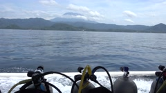 View of the Agung volcano from boat with diving tank in Padang Bai, Bali Stock Footage