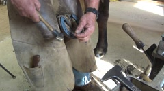 Farrier shoeing horse Stock Footage