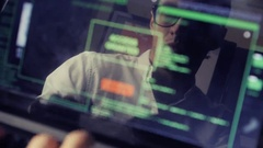 Double exposure shot of man hacker working at a laptop Stock Footage