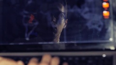 IT professional programmer in glasses is working on computer Stock Footage