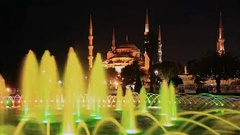 The Blue Mosque (Sultanahmet) during sunset and fountain in Istanbul Turkey Stock Footage