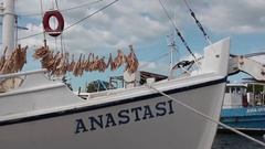 Sponges hanging to dry on the bow of a commercial sponge fishing boat. Stock Footage