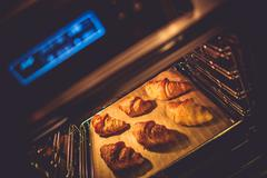 Croissant Electric Oven Baking. Tasteful Croissant Buttery Pastry. Stock Photos