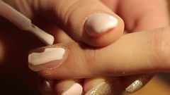 Master makes the girl manicure hands at salon Stock Footage