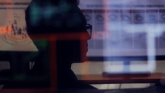 Man working at a laptop in the reflection of the monitor Stock Footage