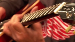 A man plays the guitar. Fiddle Stock Footage