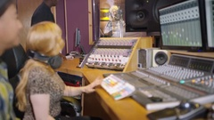 4K Professional team in recording studio mixing a track with female vocalist Stock Footage