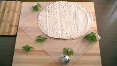 Preparation of pizza on an unleavened wheat cake with chicken fillet. Stock Footage