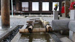 Purifying fountain at SangenSanDo temple, Kyoto Stock Footage