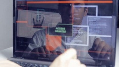 Double exposure shot of man hacker with glasses working at computer Stock Footage